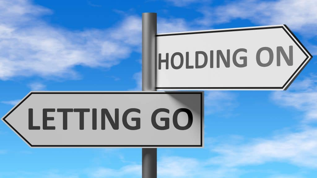 Letting Go and Holding On - text on signs pointing two directions