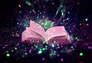purple open book against sparkles in sky