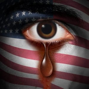 A crying eye on an American flag, a metaphor for our history